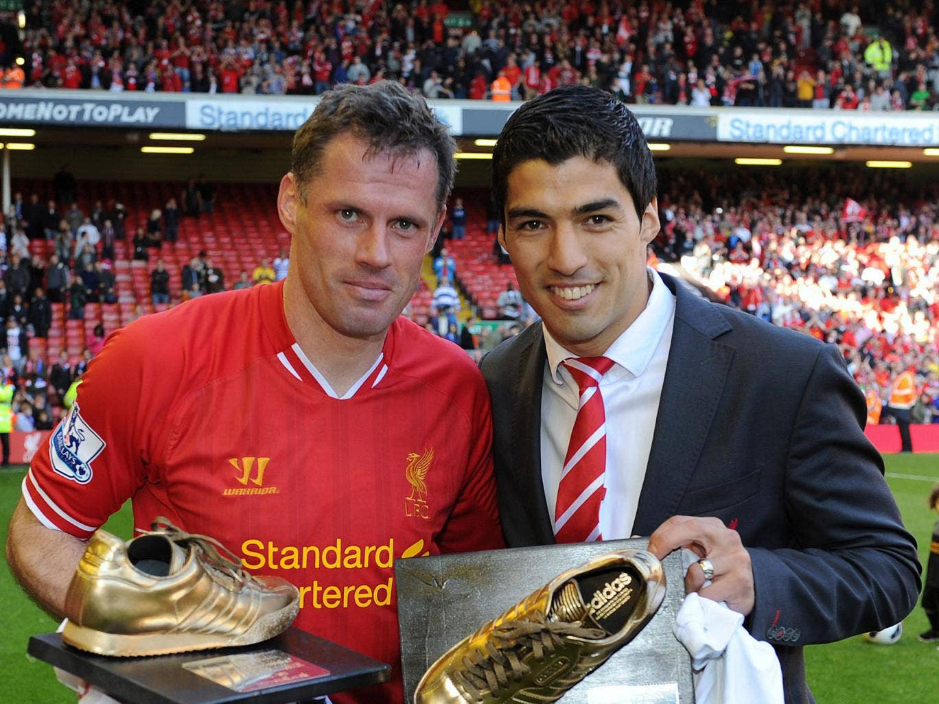 Jamie Carragher and Luis Suarez of Liverpool pose at the end of the Barclays Premier League match