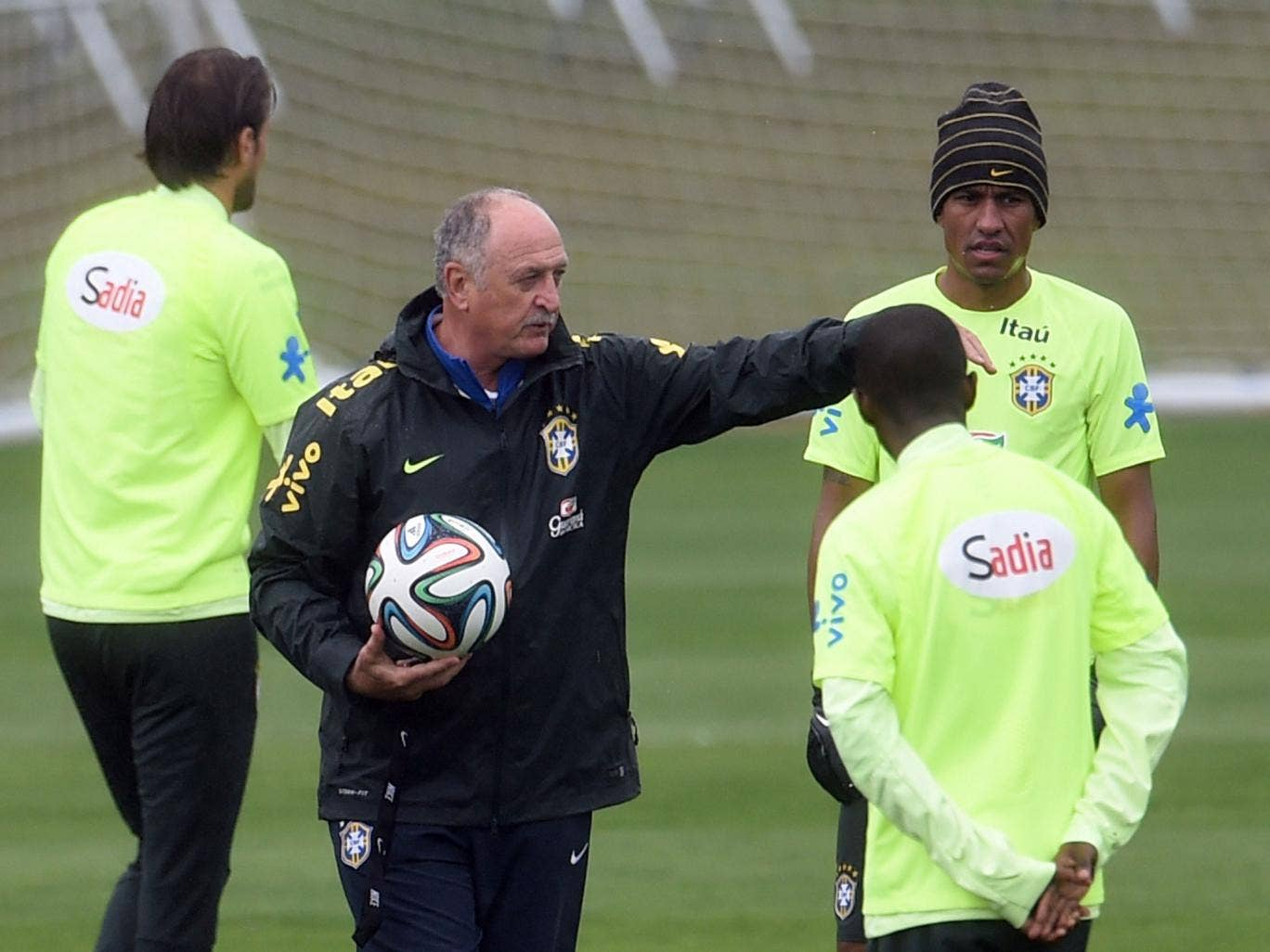 Brazil's coach Luiz Felipe Scolari speaks with players as they take part in a training session