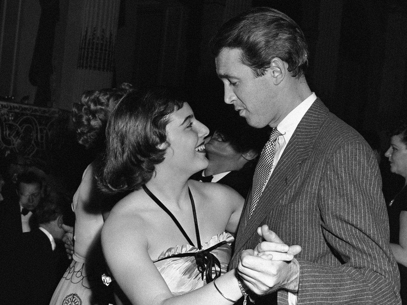 Mary Rodgers dances with James Stewart at the 'Oklahoma!' fifth birthday party in 1943