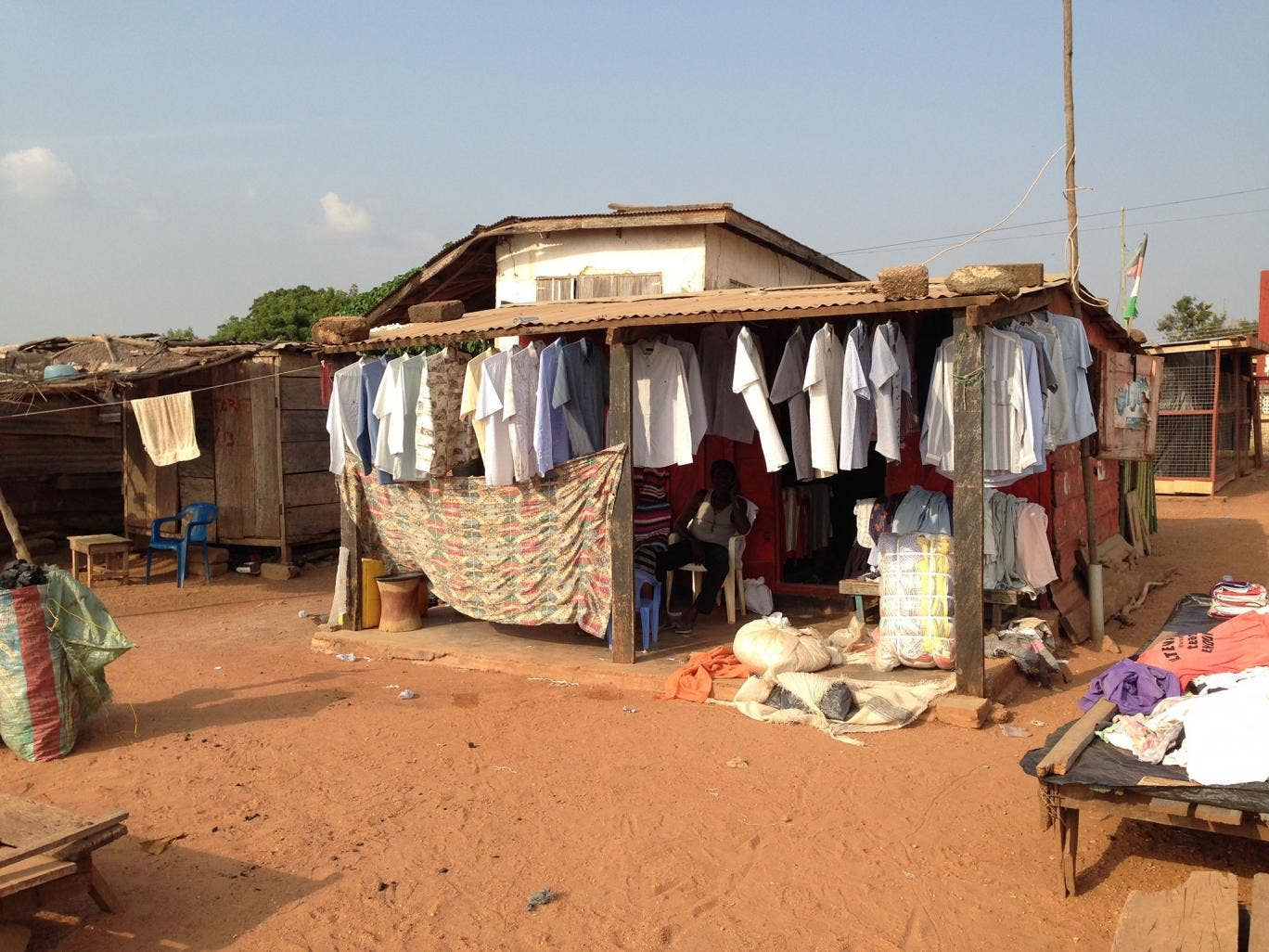 In Kumasi, bales of British charity clothing change hands for £40