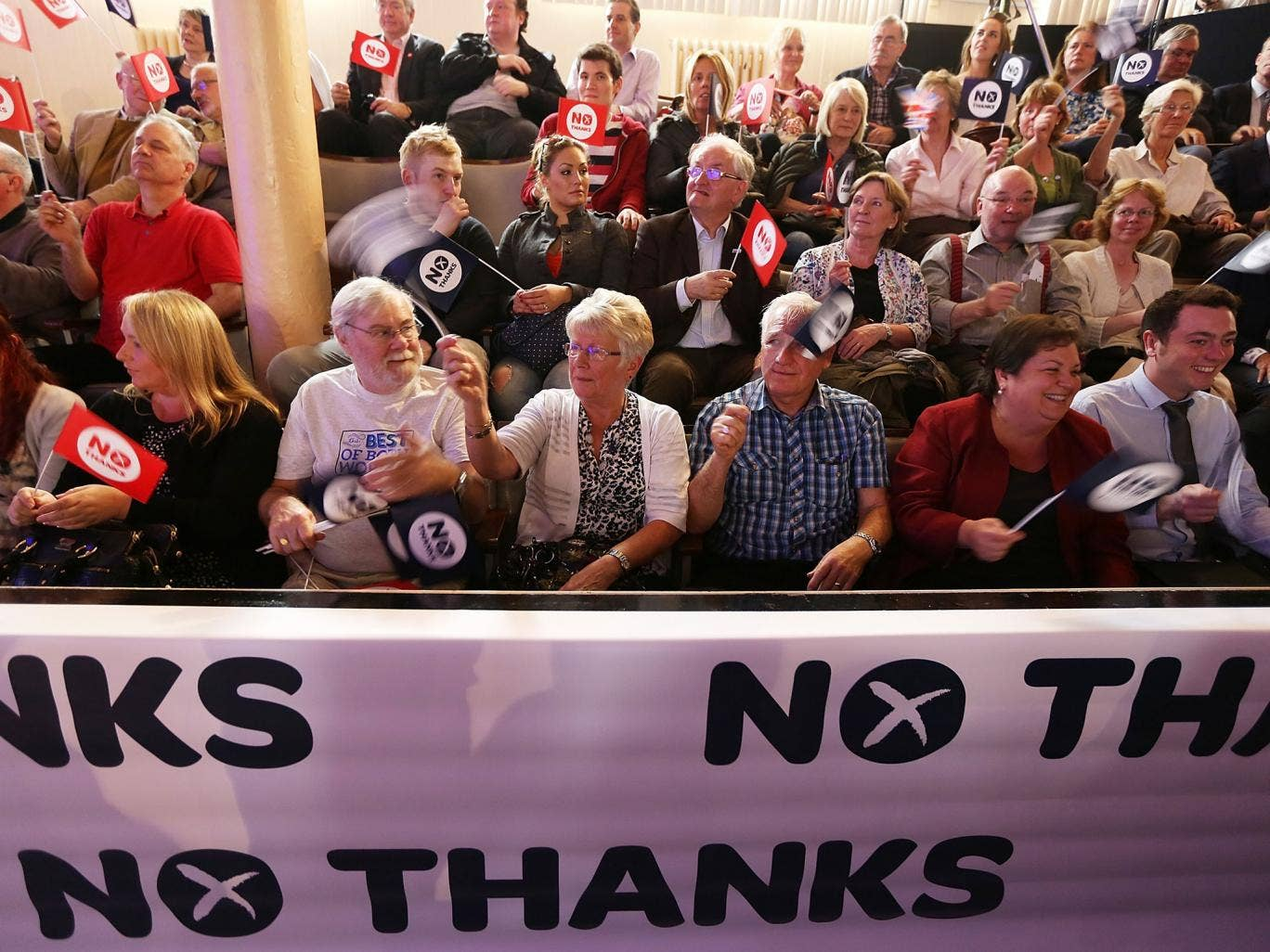 'Better Together' supporters wave their flags