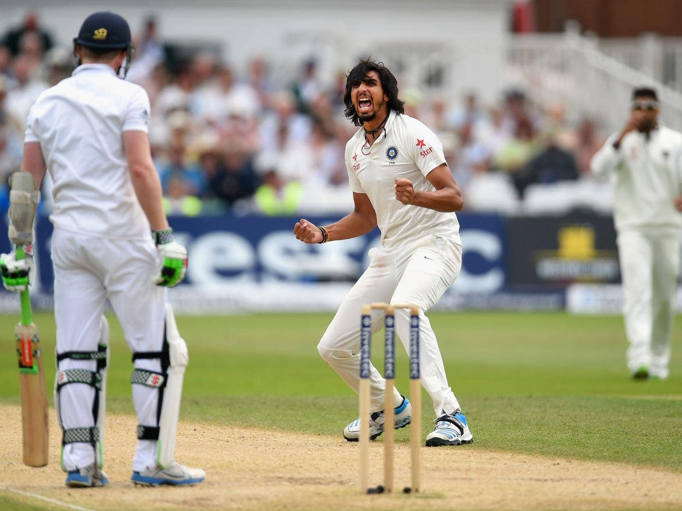 Indian paceman Ishant Sharma celebrates taking the wicket of England's Sam Robson at Trent Bridge yesterday