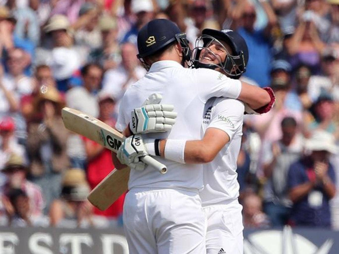 The odd couple: Joe Root (right) celebrates with Jimmy Anderson after reaching his century during the last-wicket pair's 198-run stand at Trent Bridge