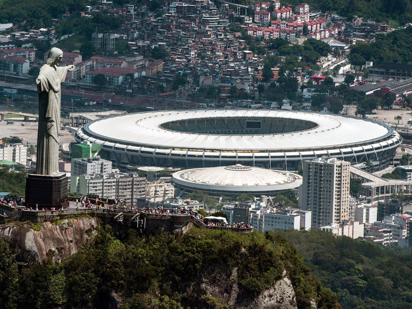 Aerial view of the Christ the Redeemer statue atop Corcovado Hill and the Mario Filho (Maracana) stadium in Rio de Janeiro, Brazil, on December 3, 2013.