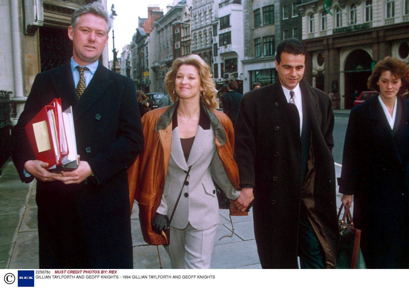 Brief encounter: Gillian Taylforth, with her partner Geoff Knights (right), arriving in court in 1994 for her libel trial with 'The Sun'