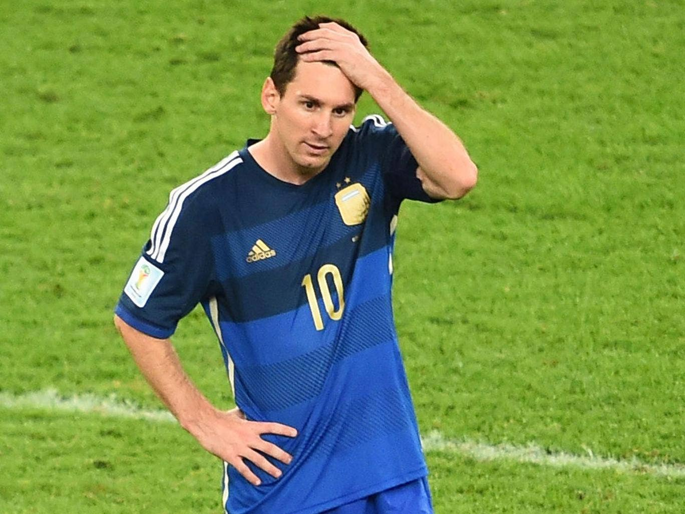 Lionel Messi looks on at the end of the final