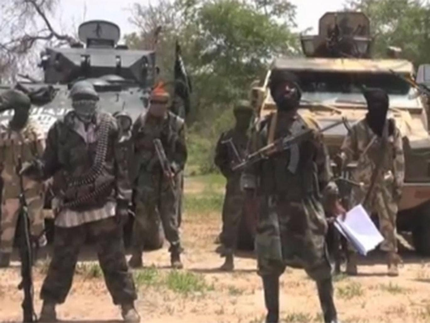 Boko Haram's leader Abubakar Shekau (R) delivers his message