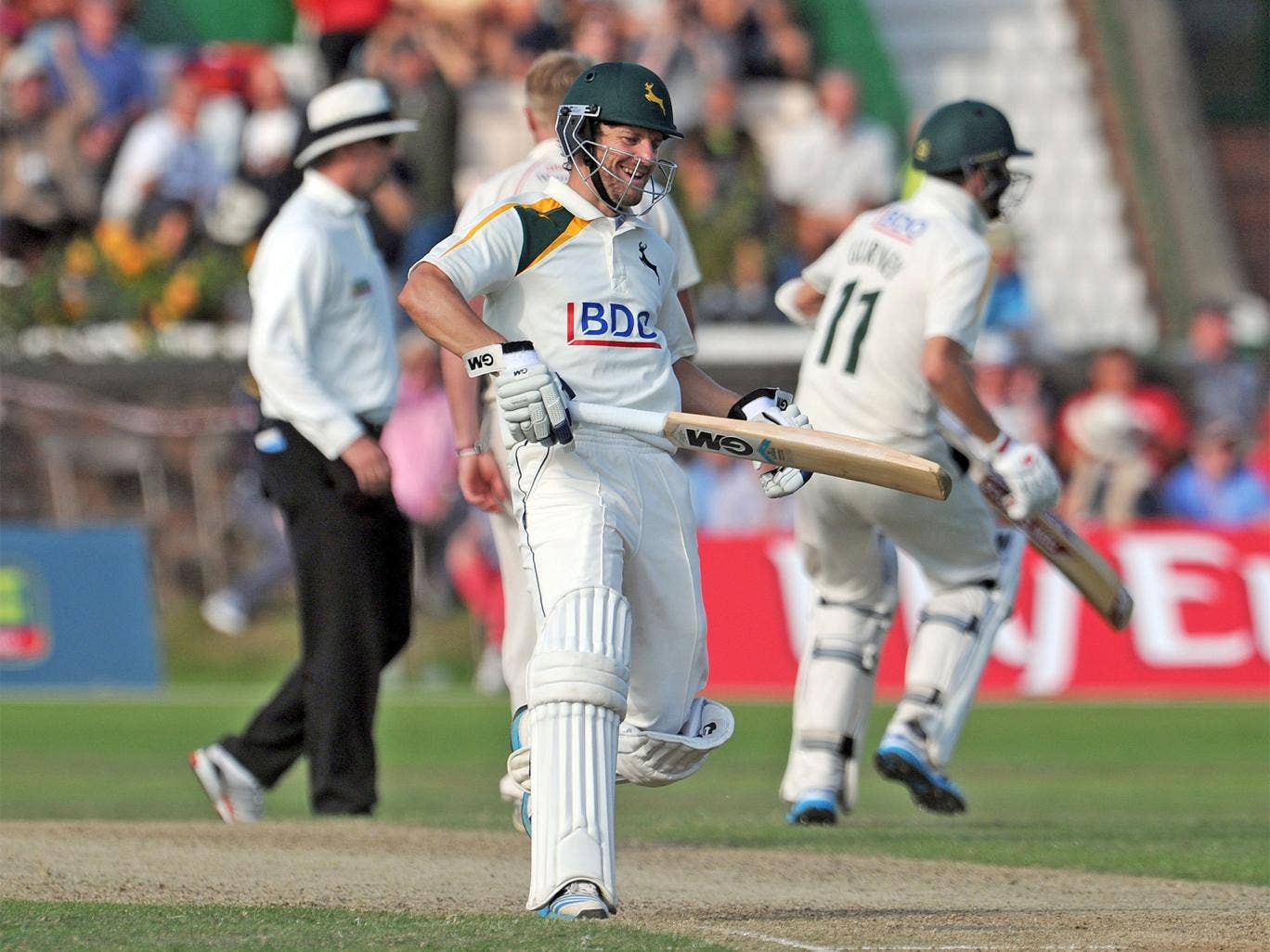Chris Read (centre) celebrates after Harry Gurney (right) scored the winning run for Notts