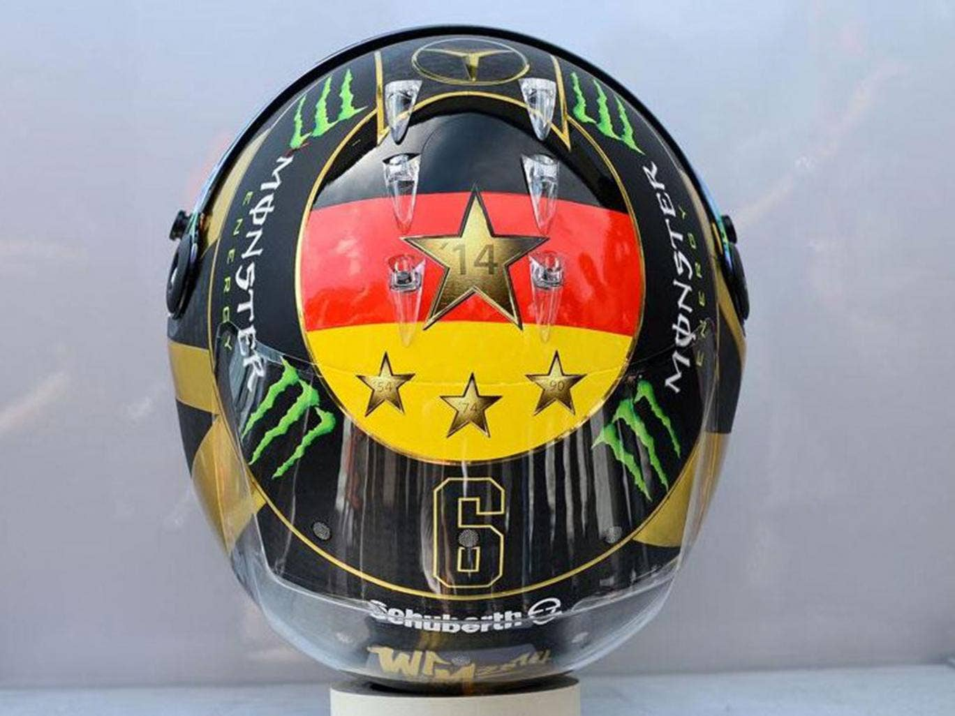 Nico Rosberg has had to change the planned design of his F1 helmet because it previously featured an image of the World Cup trophy