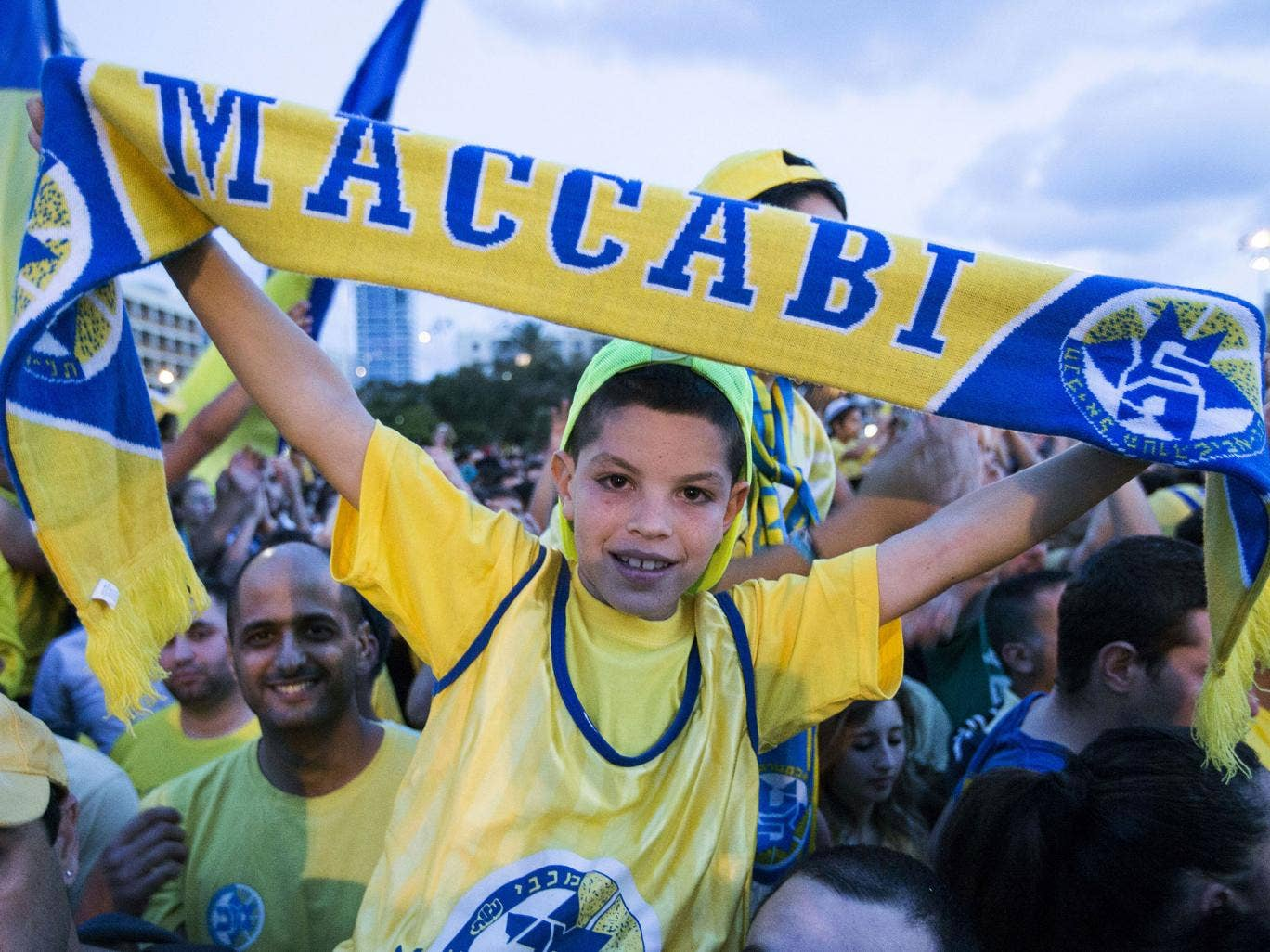 Maccabi Tel Aviv fans celebrate their team's win in Kikar Rabin or Rabin Square in Tel Aviv, on May 19, 2014, following last night's victory over Real Madrid in the Euroleague 2014