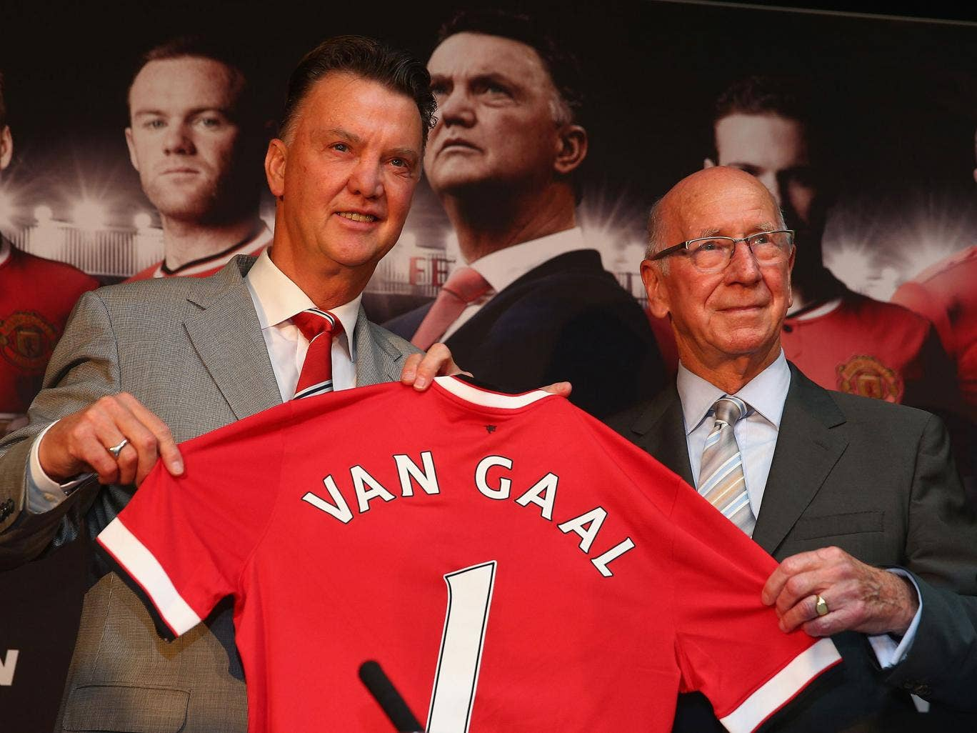 Louis van Gaal is unveiled at Manchester United alongside club ambassador Sir Bobby Charlton
