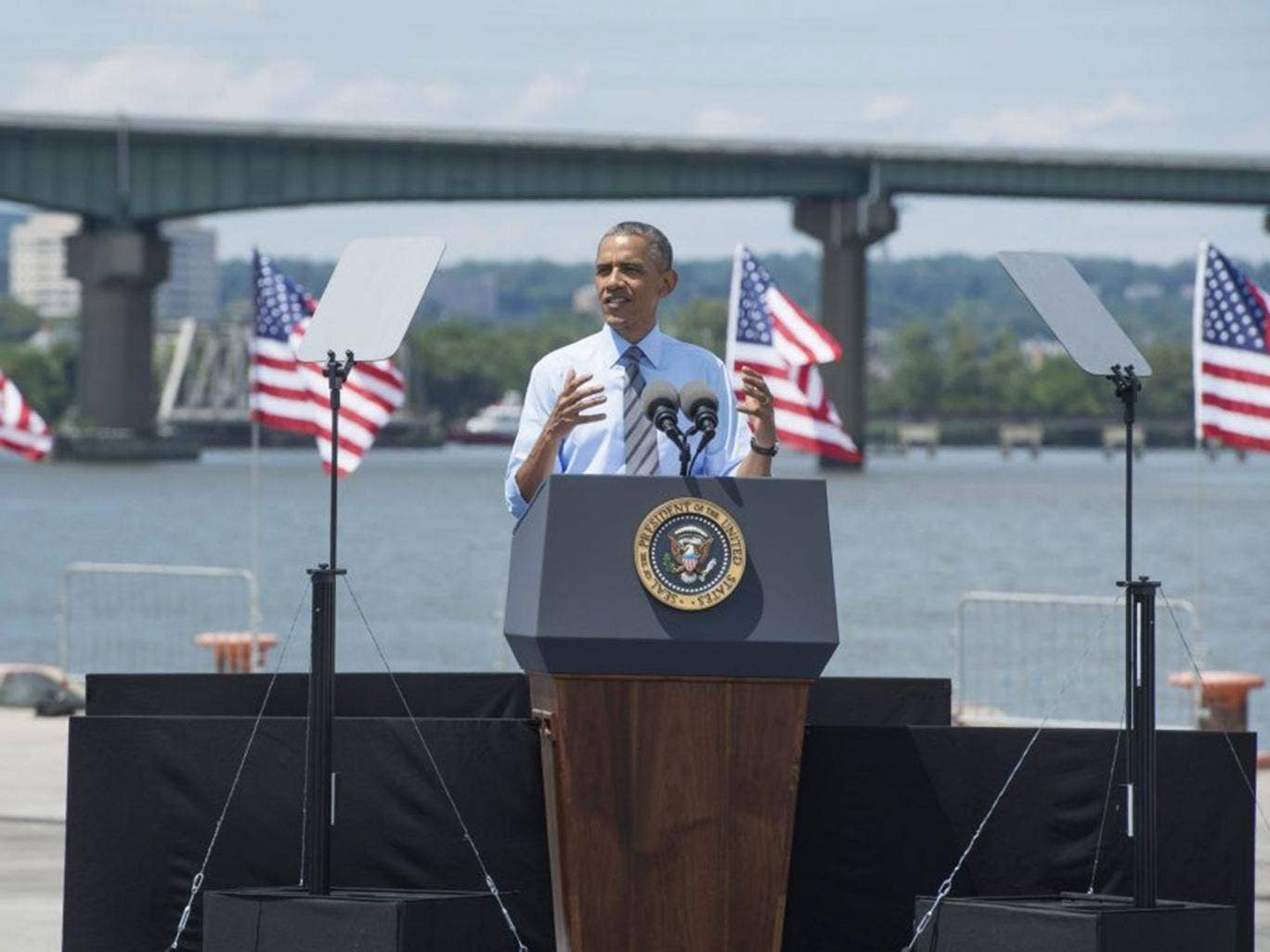 US President Barack Obama delivers remarks on infrastructure in front of the Interstate 495 Bridge at the Port of Wilmington, in Wilmington, Delaware, USA, 17 July 2014. Obama delivered remarks and signed an initiative to increase private sector investmen