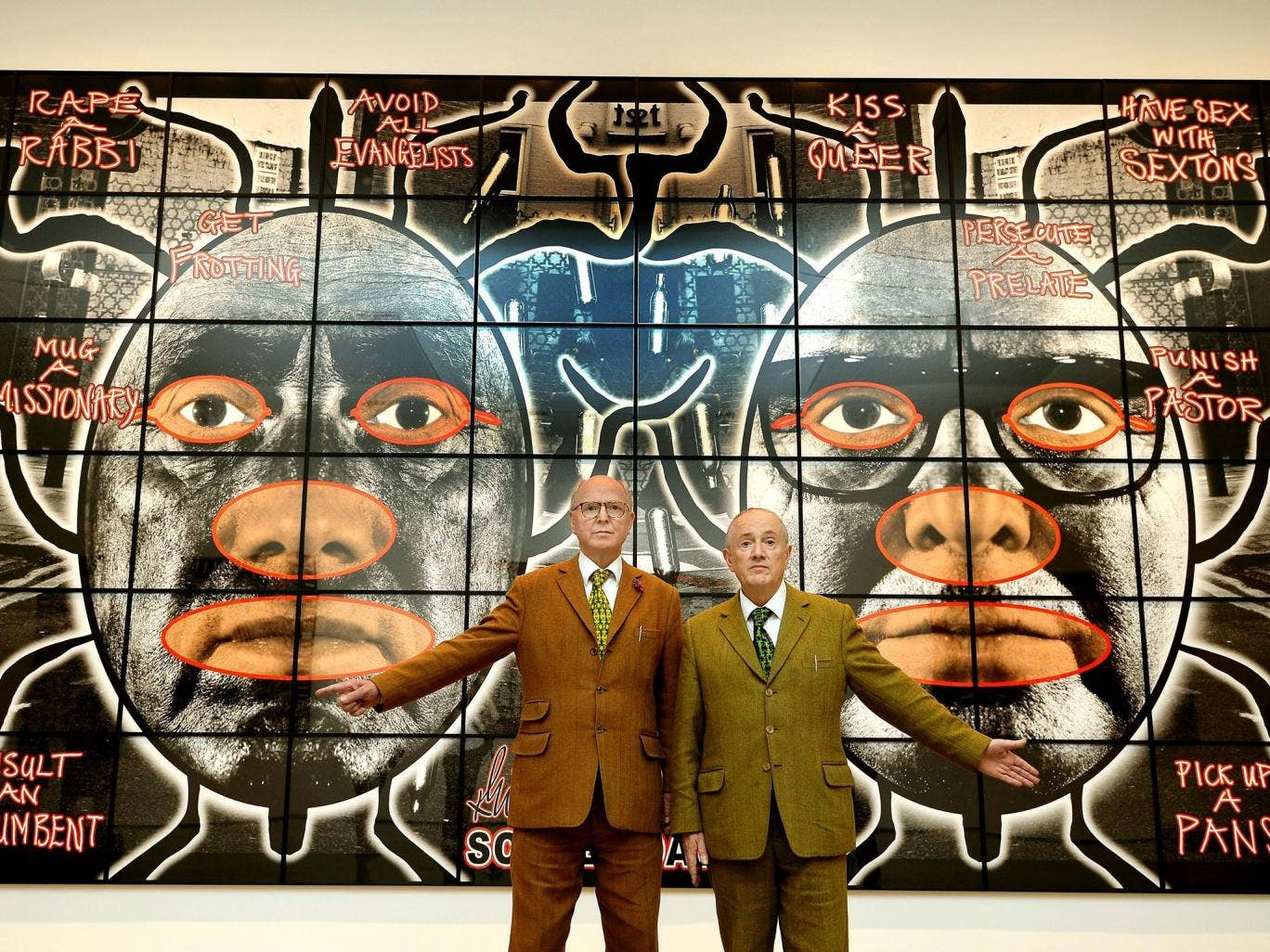 Gilbert and George in front of one of their new artworks, '10'