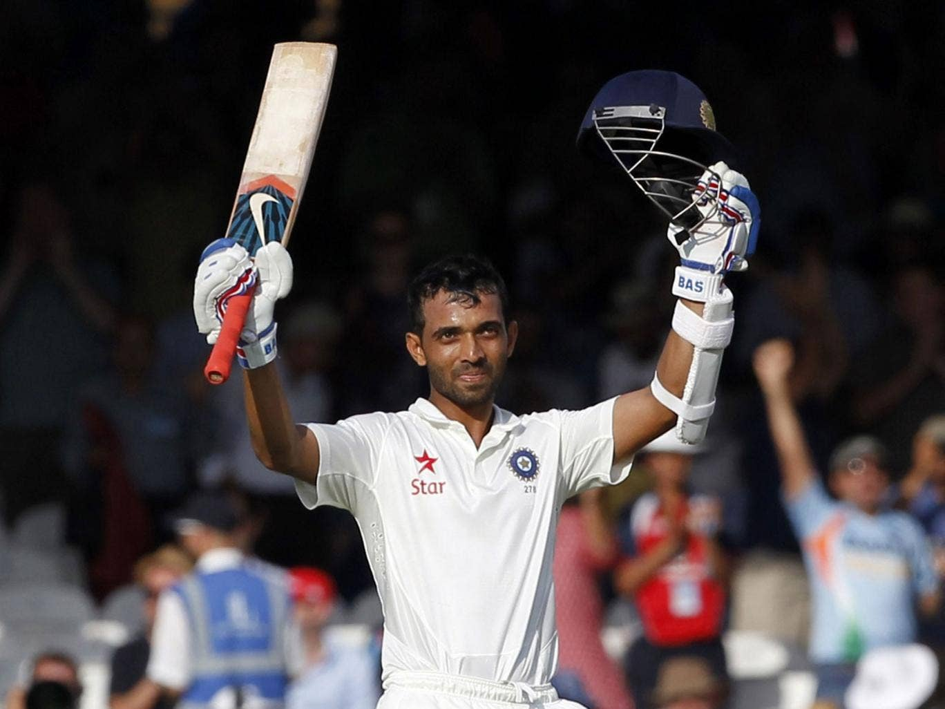 Ajinkya Rahane acknowledges the applause of the crowd after completing his century