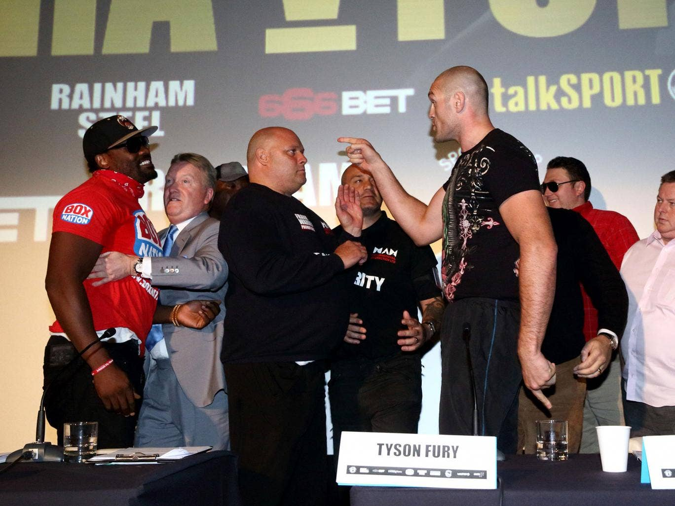 Dereck Chisora And Tyson Fury go head-to-head as they make a £10,000 side-bet during a press conference to announce the upcoming fight