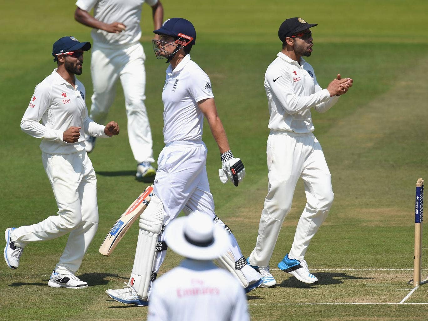 Alaistair Cook walks back to the pavilion after India bowl him out for 10