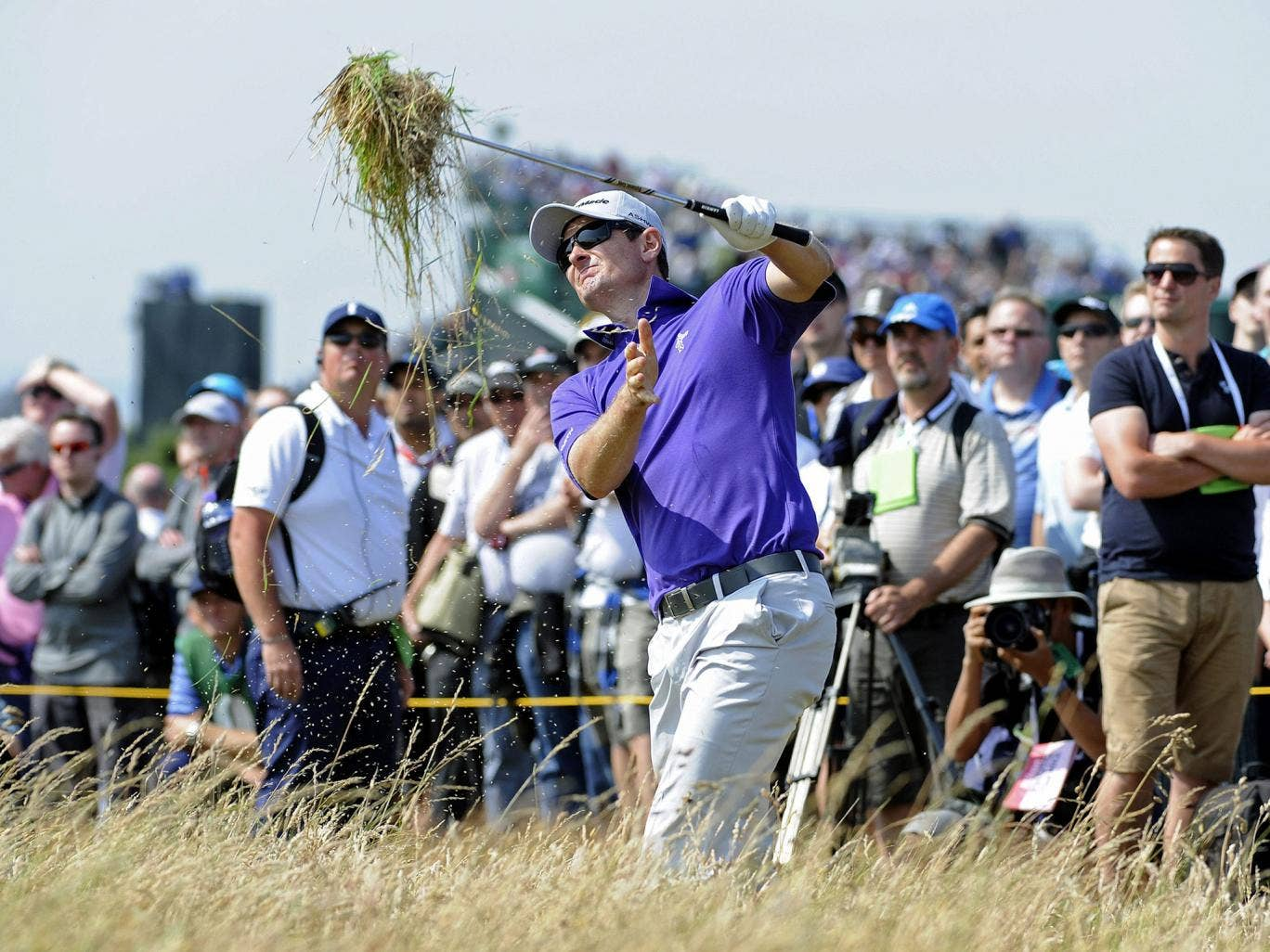 Justin Rose brings in the harvest as he plays out of the rough at the seventh yesterday