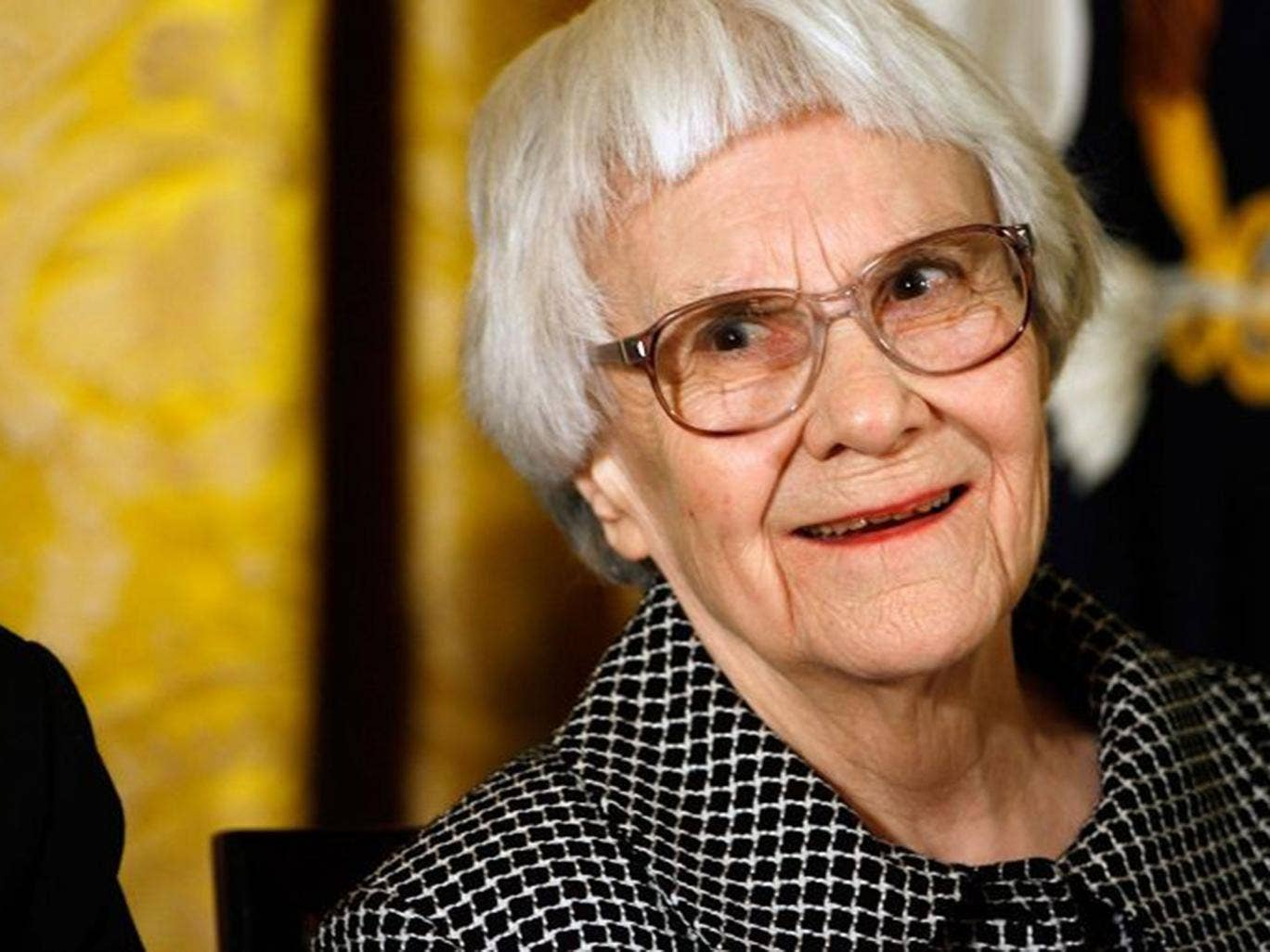 Harper Lee smiles before receiving the 2007 Presidential Medal of Freedom