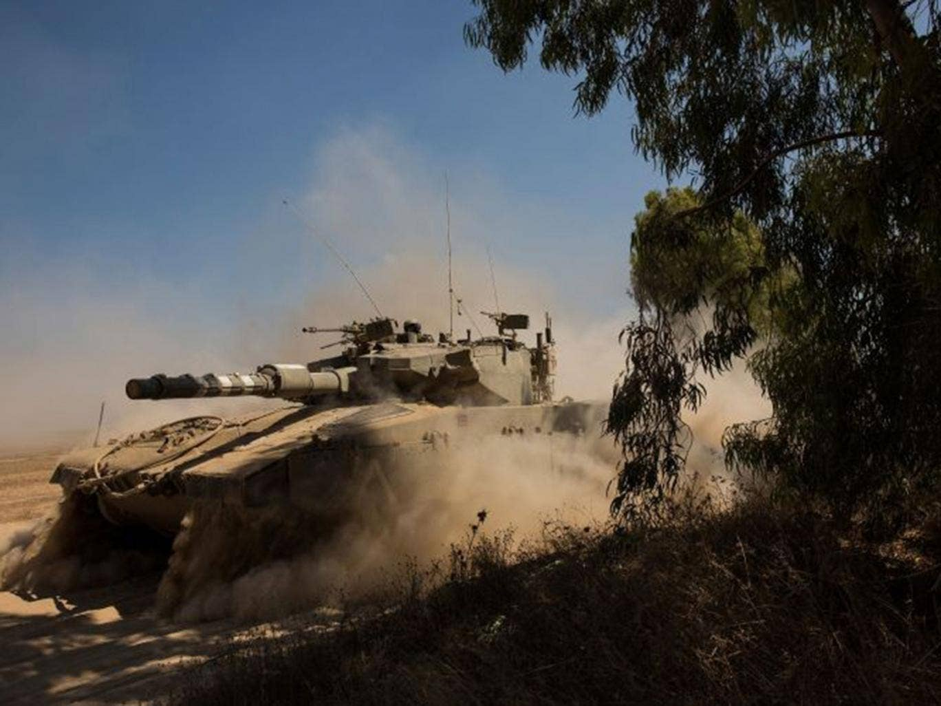 An Israeli tank on its way to the border with Gaza yesterday