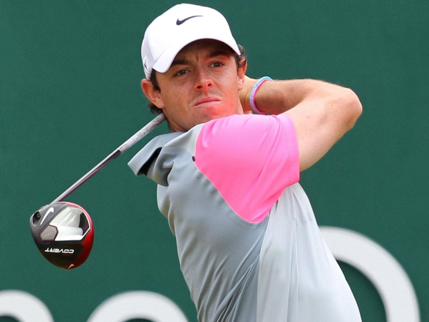Rory McIlroy watches his shot from the 1st tee today