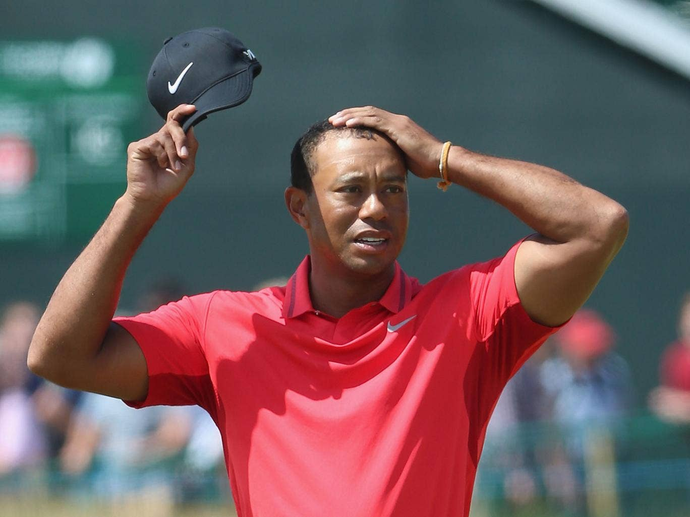 Tiger Woods looks on at the 18th hole today