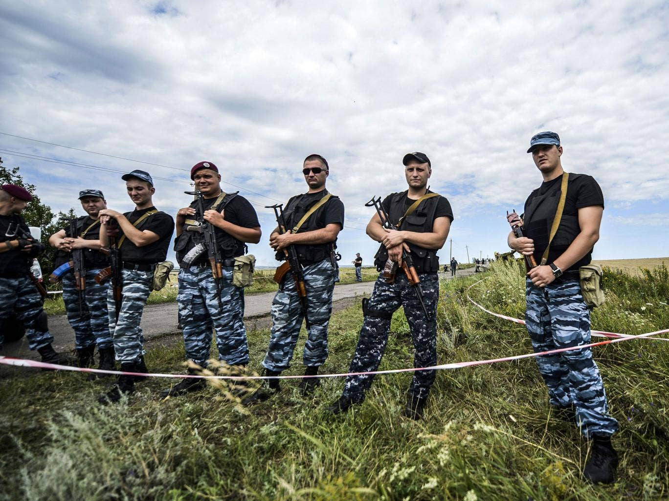 Pro-Russian separatists block the way to the crash site of MH17, near the village of Grabove