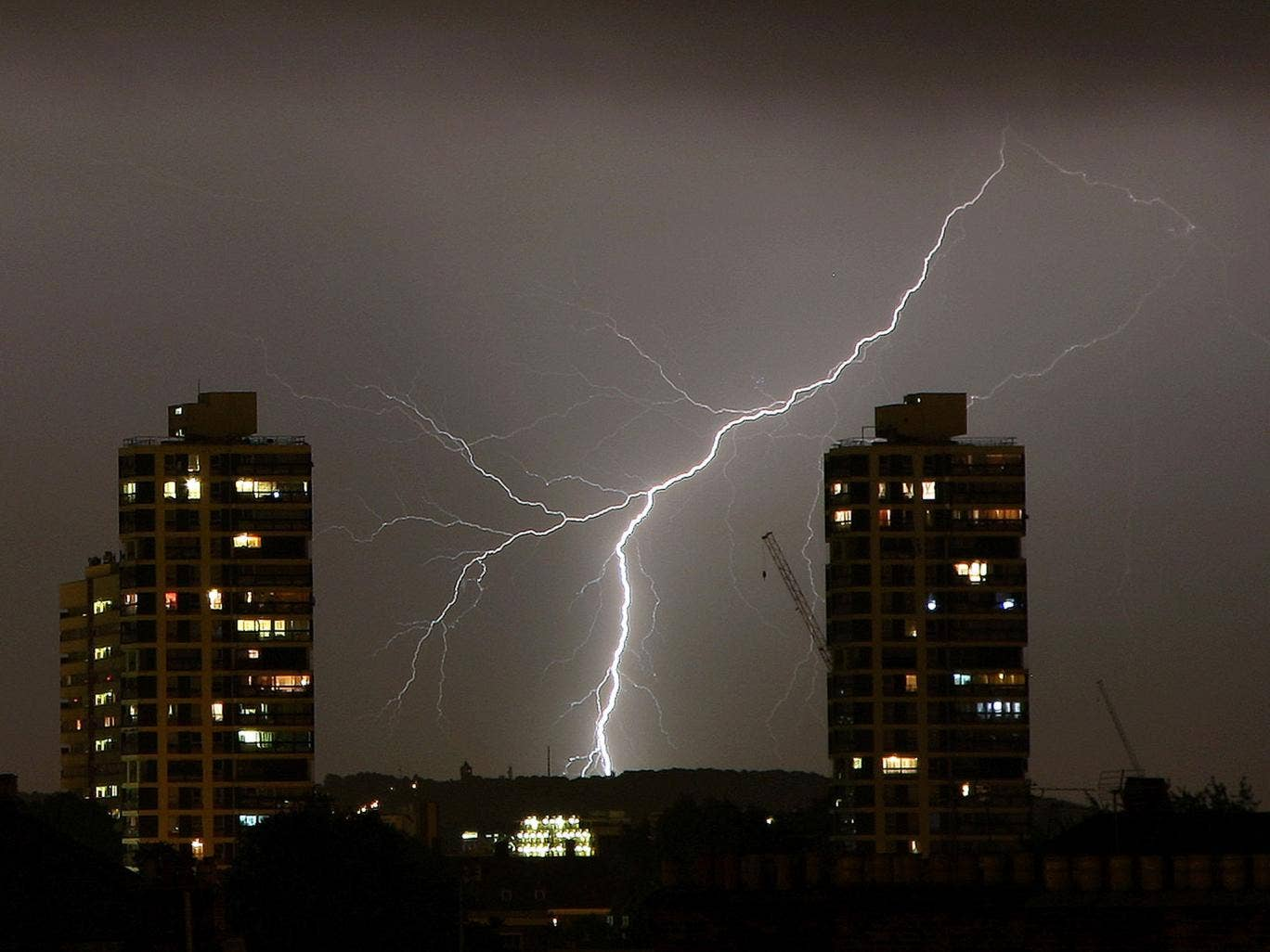 Lightning flashes in the night sky over South London
