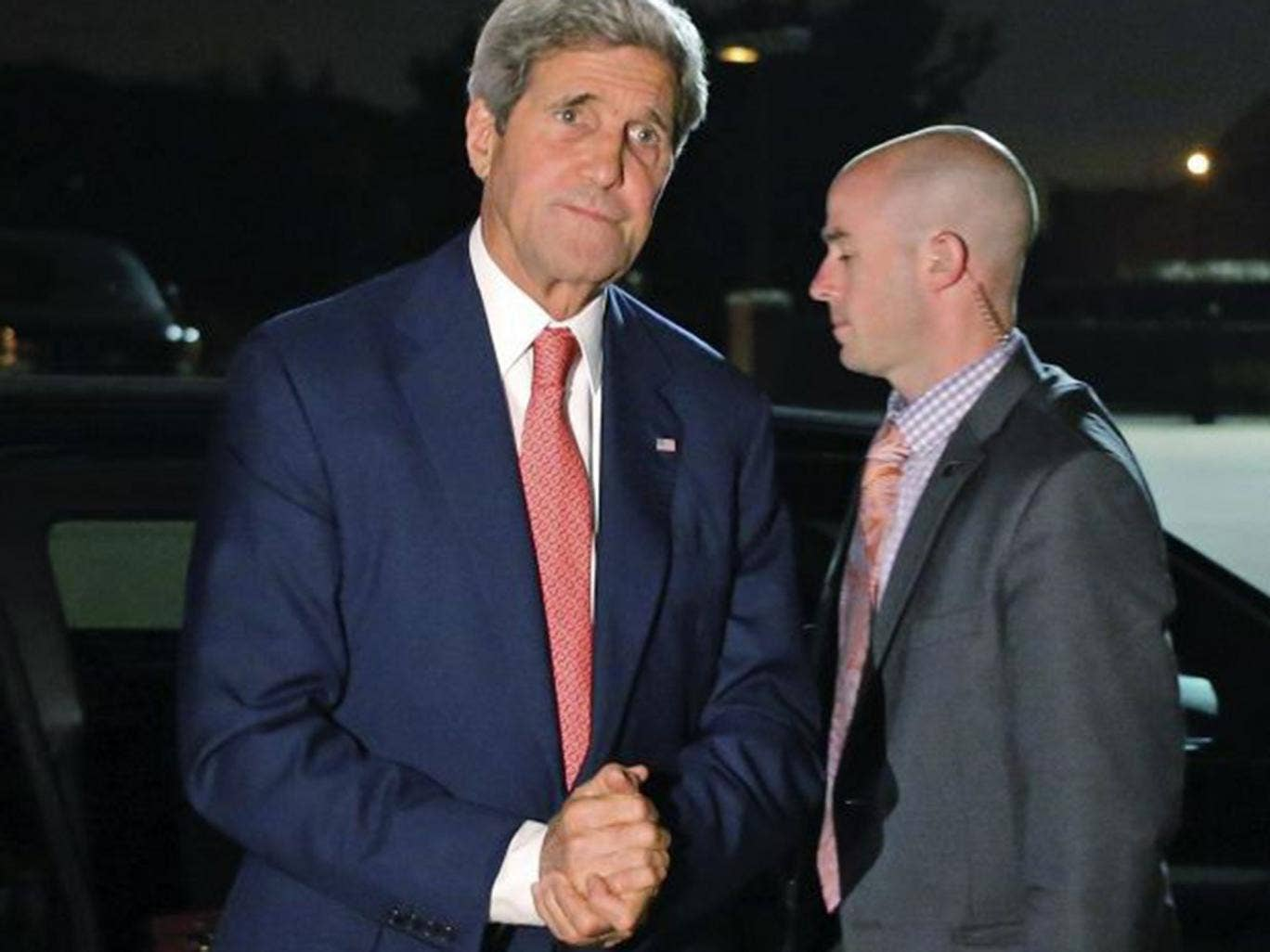 Kerry steps out of his vehicle to board his plane at Andrews Air Force Base as he begins his trip to the Middle East