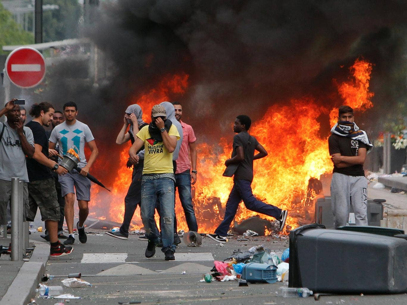 Rioters face riot police, following a pro-Palestinian demonstration, in Sarcelles, north of Paris.  French youth defying a ban on a protest against Israel's Gaza offensive went on a rampage in a Paris suburb, setting fire to cars and garbage cans after a