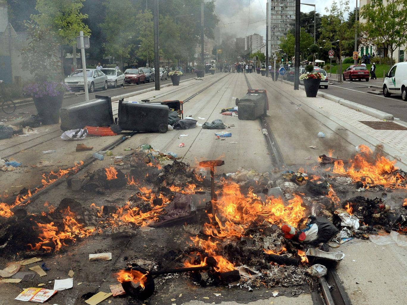 Burning detritus are seen along the tramway line in Sarcelles, a suburb north of Paris, on July 20, 2014, after clashes following a demonstration denouncing Israel's military campaign in Gaza