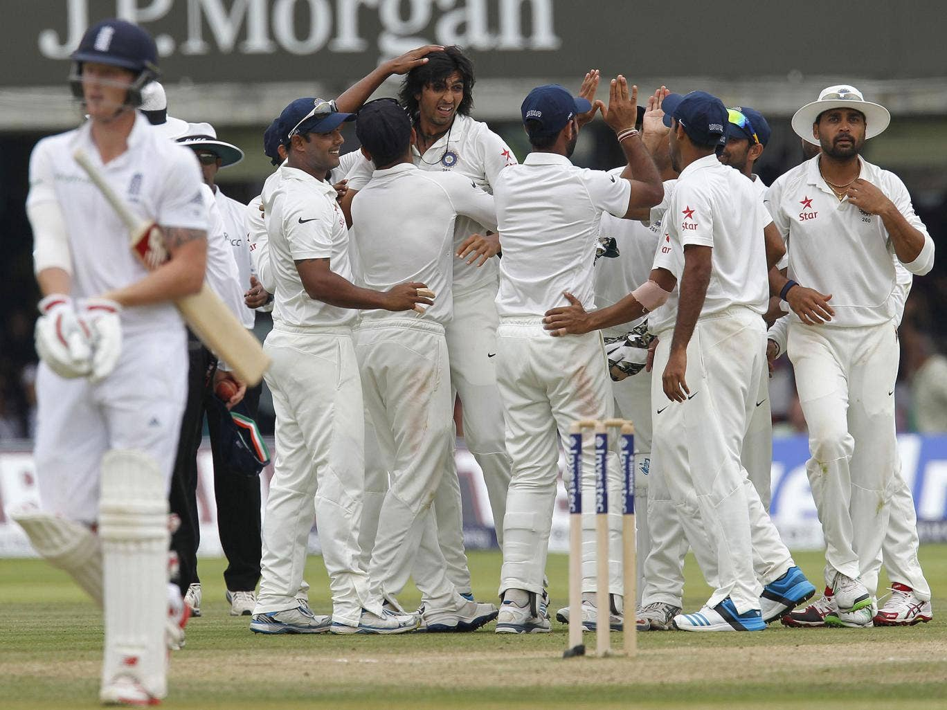 Ben Stokes trudges off after his latest batting failure for England as Ishant Sharma celebrates one of his seven wickets