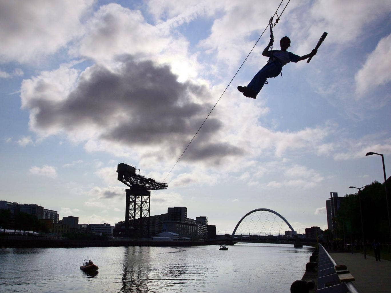 Batonbearer 010 Nina Saunders carrying the Glasgow 2014 Queen's Baton on a zip wire from Finnieston Crane in Glasgow