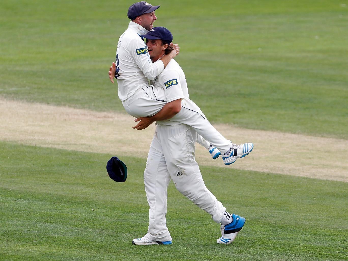 Adam Lyth jumps on Jack Brooks after taking the last wicket