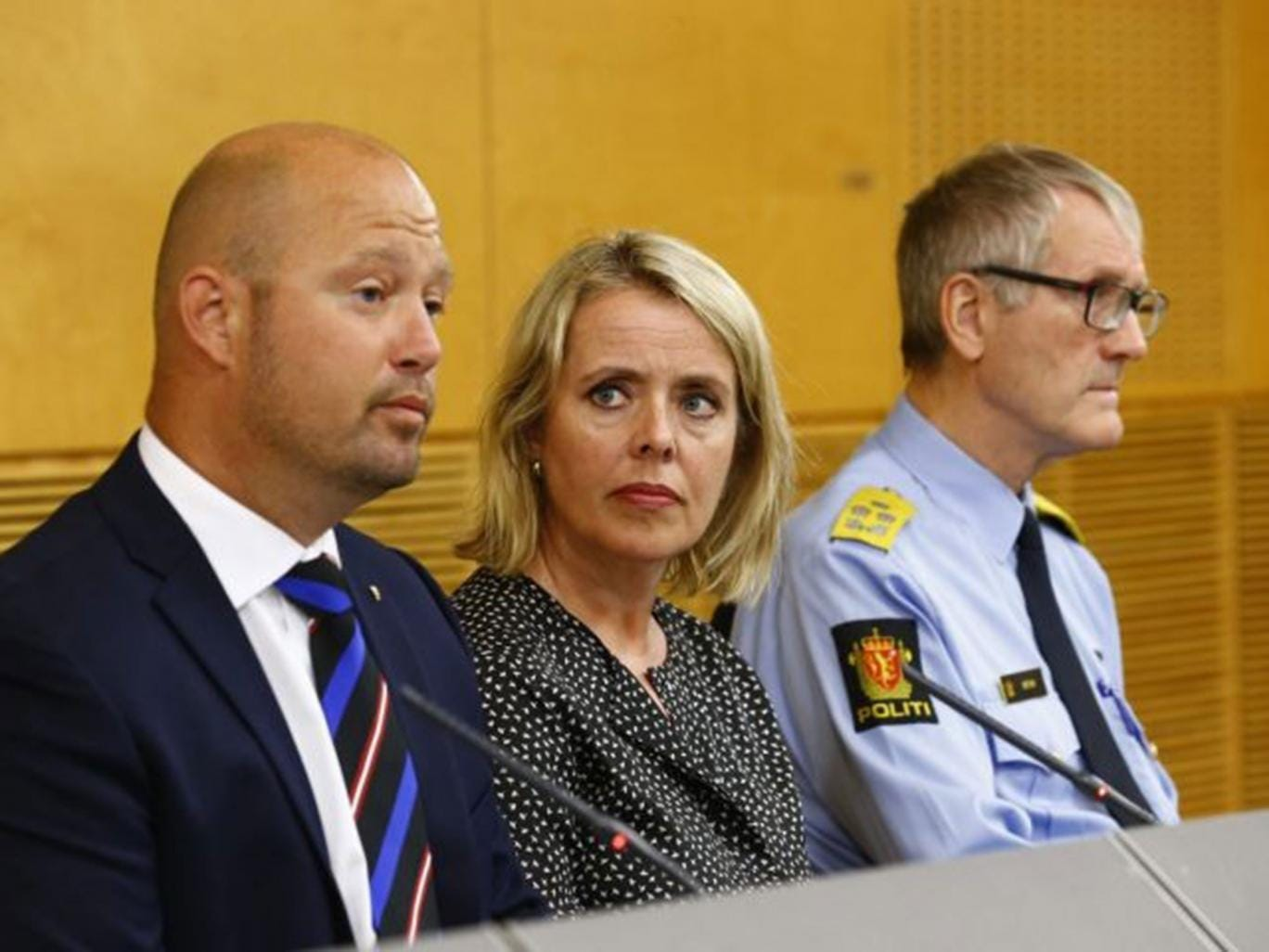 Minister of Justice and Public Security, Anders Anundsen, left, the head of the Norwegian intelligence service (PST), Benedicte Bjoernland and head of the police Vidar Refvik, right, during a press conference in Oslo on Thursday, 24 July, 2014
