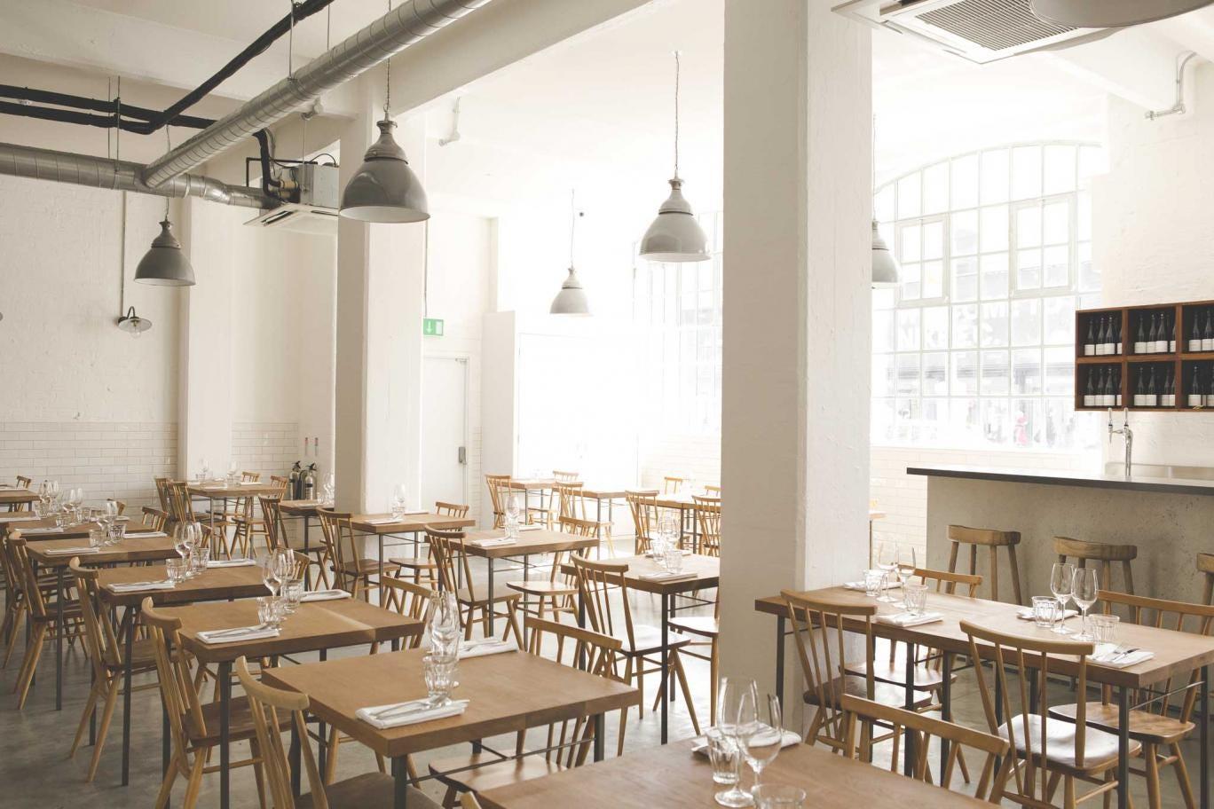 Lyle's décor is spartan: school-lavatory white tiles, concrete floor, junior tables and chairs