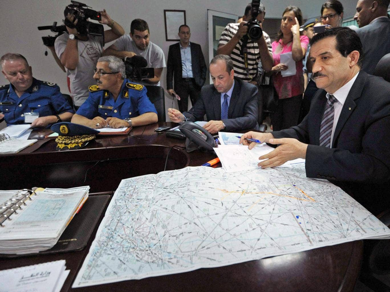Algerian Minister of Transport Amar Ghoul (R) chairs an Algerian crisis unit meeting at the Houari-Boumediene International Airport in Algiers, Algeria, 24 July 2014