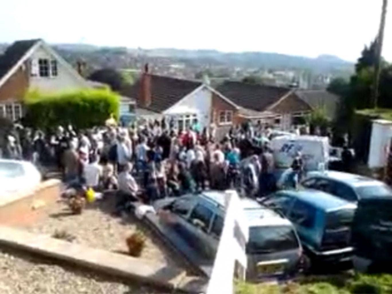 Hundreds gathered to form human barrier in front of Crawford's house