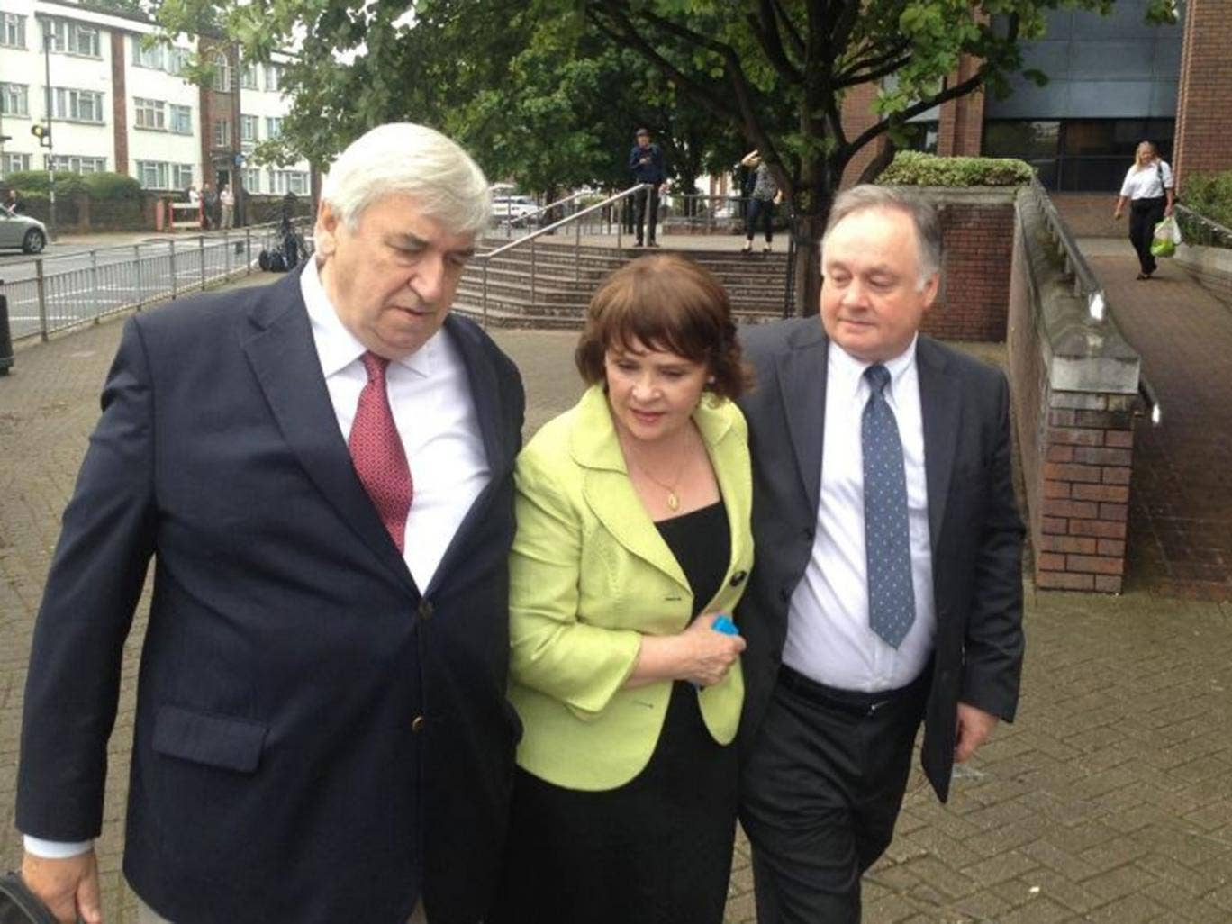 John Brown (right) with his sister, Eurovision Song Contest winner and former Irish presidential candidate Dana Rosemary Scallon, and her husband Damien Scallon, as he leaves Harrow Crown Court after he was found not guilty of five counts of historic sex