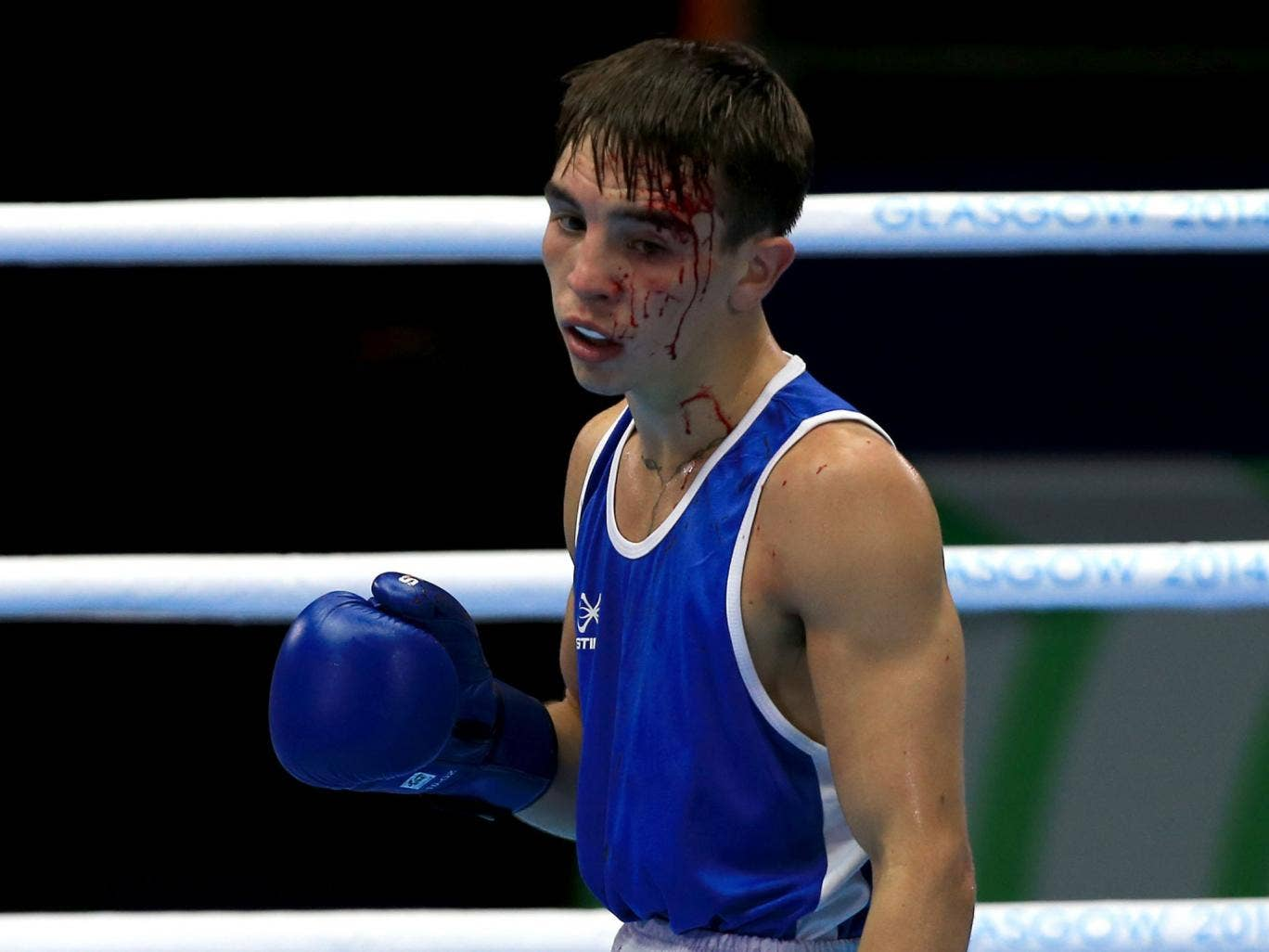 Northern Ireland's Michael Conlan hung on to win yesterday despite a cut