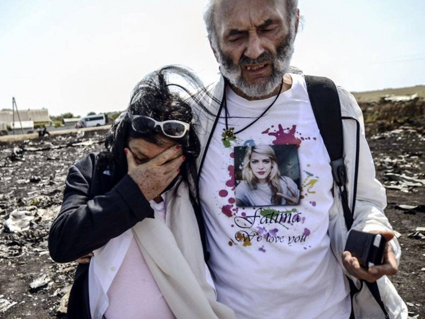 Jerzy Dyczynsk (R) and Angela Rudhart-Dyczynski from Australia react as they arrive on July 26, 2014 at the crash site of the Malaysia Airlines Flight MH17 to look for their late daughter Fatima