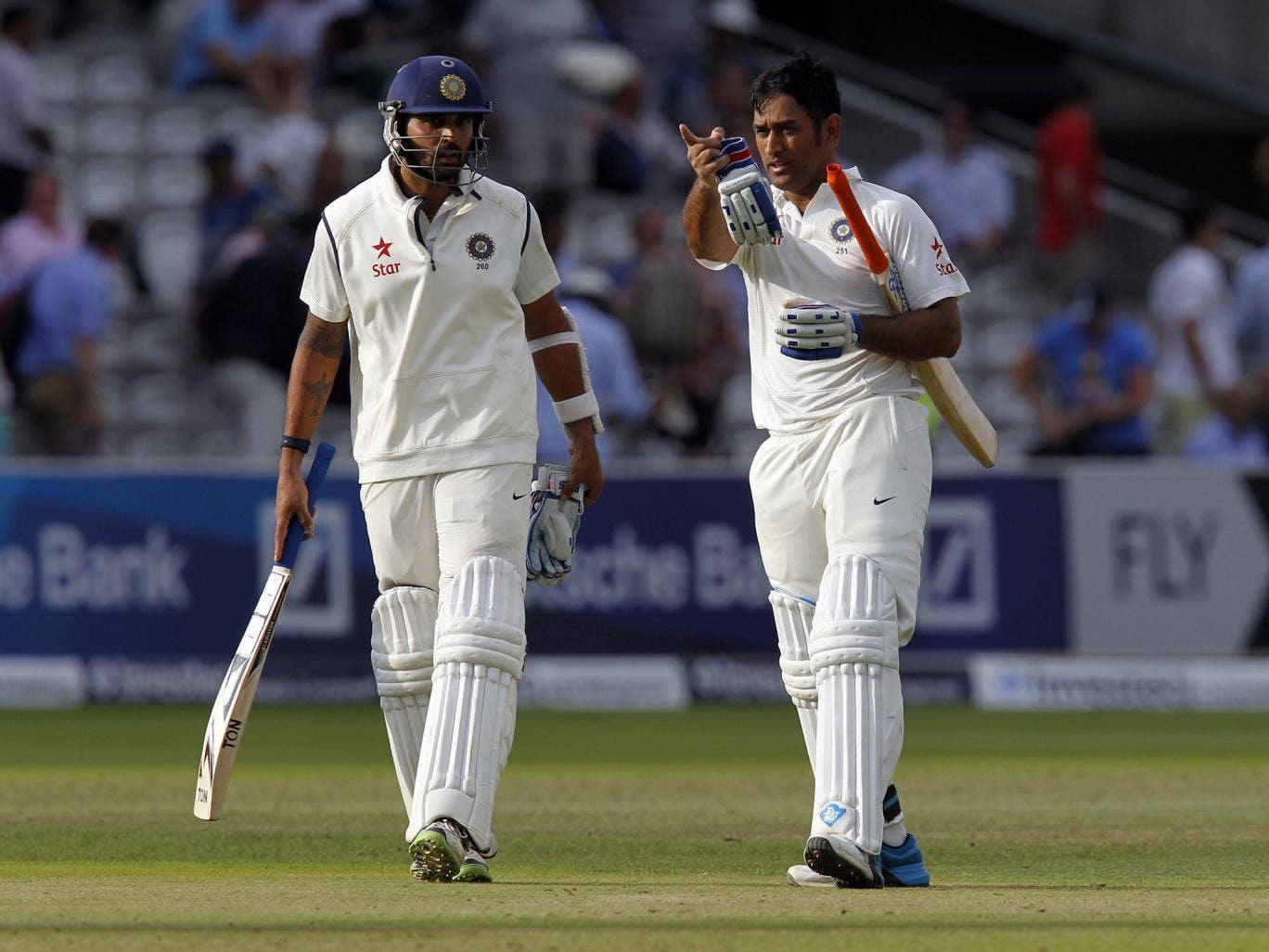 Indias Murali Vijay (L) and Indias Captain MS Dhoni