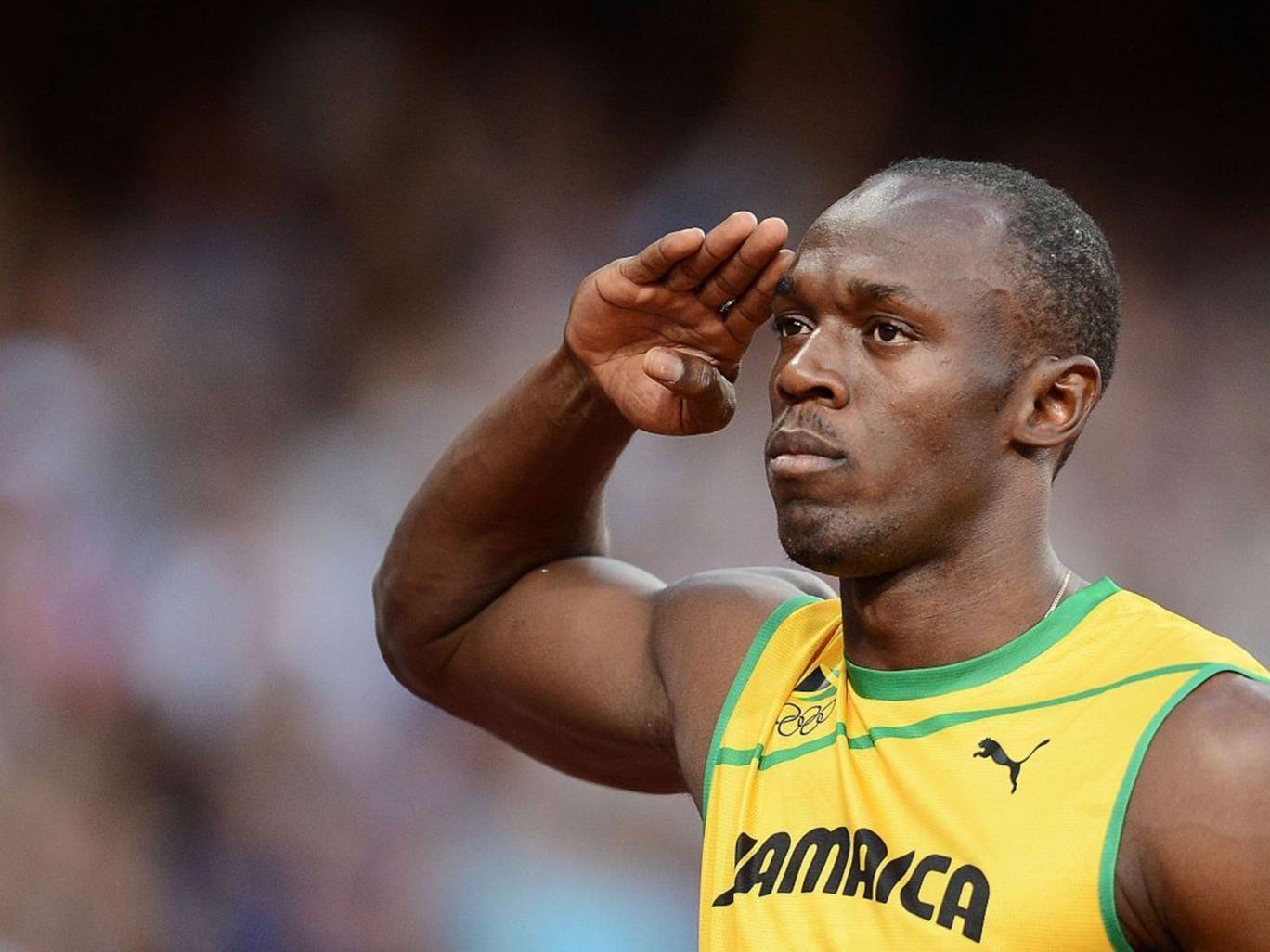 Bolt salutes the Jamaican flag