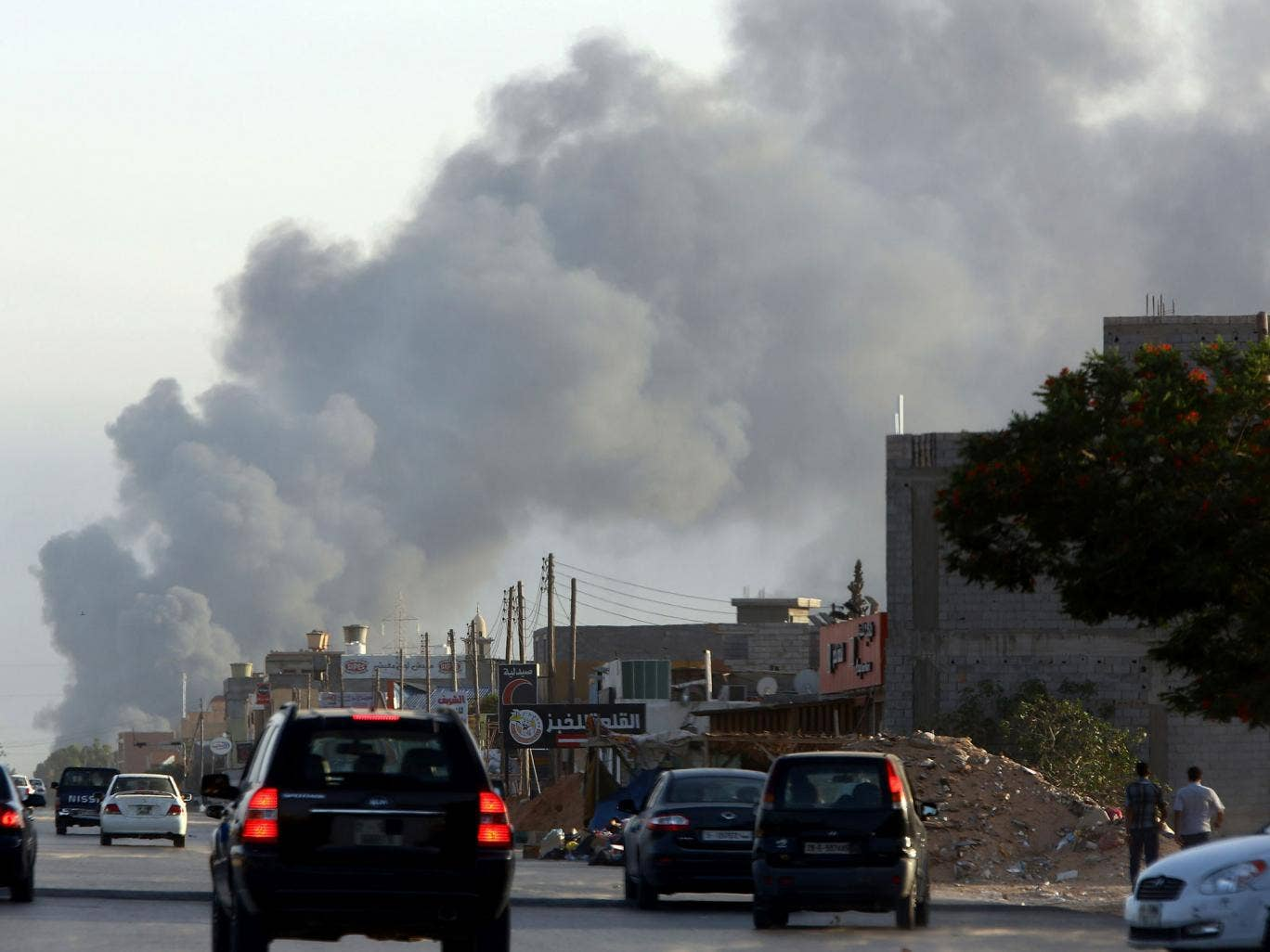 Smoke billows from an area near Tripoli's international airport during fighting between rival factions around the capital's airport