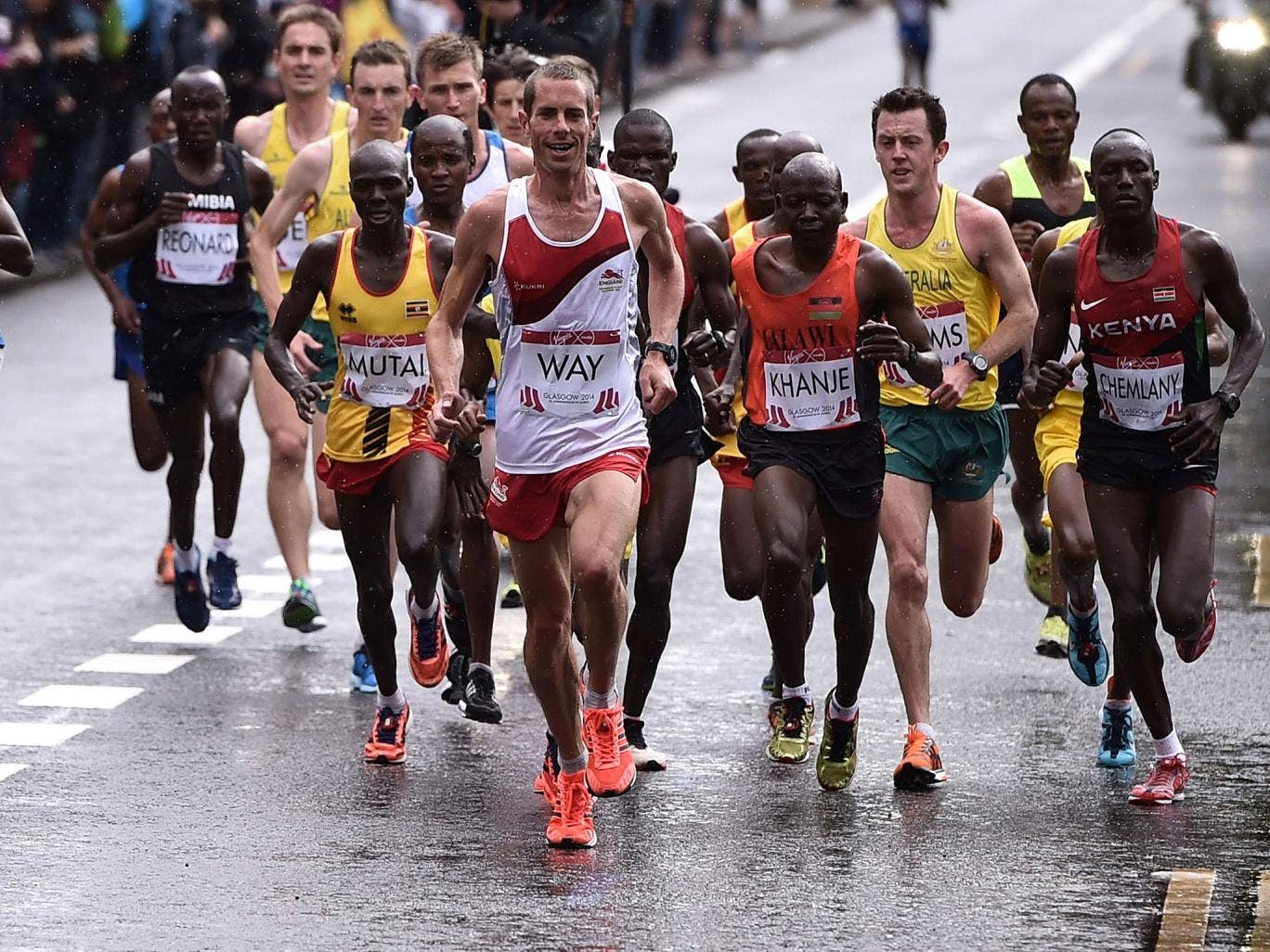 Steve Way leading the marathon, before finishing 10th, the top English runner