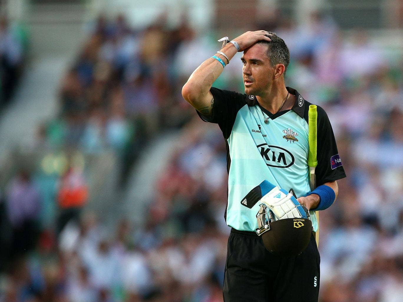 Kevin Pietersen walks off the pitch for Surrey after being dismissed