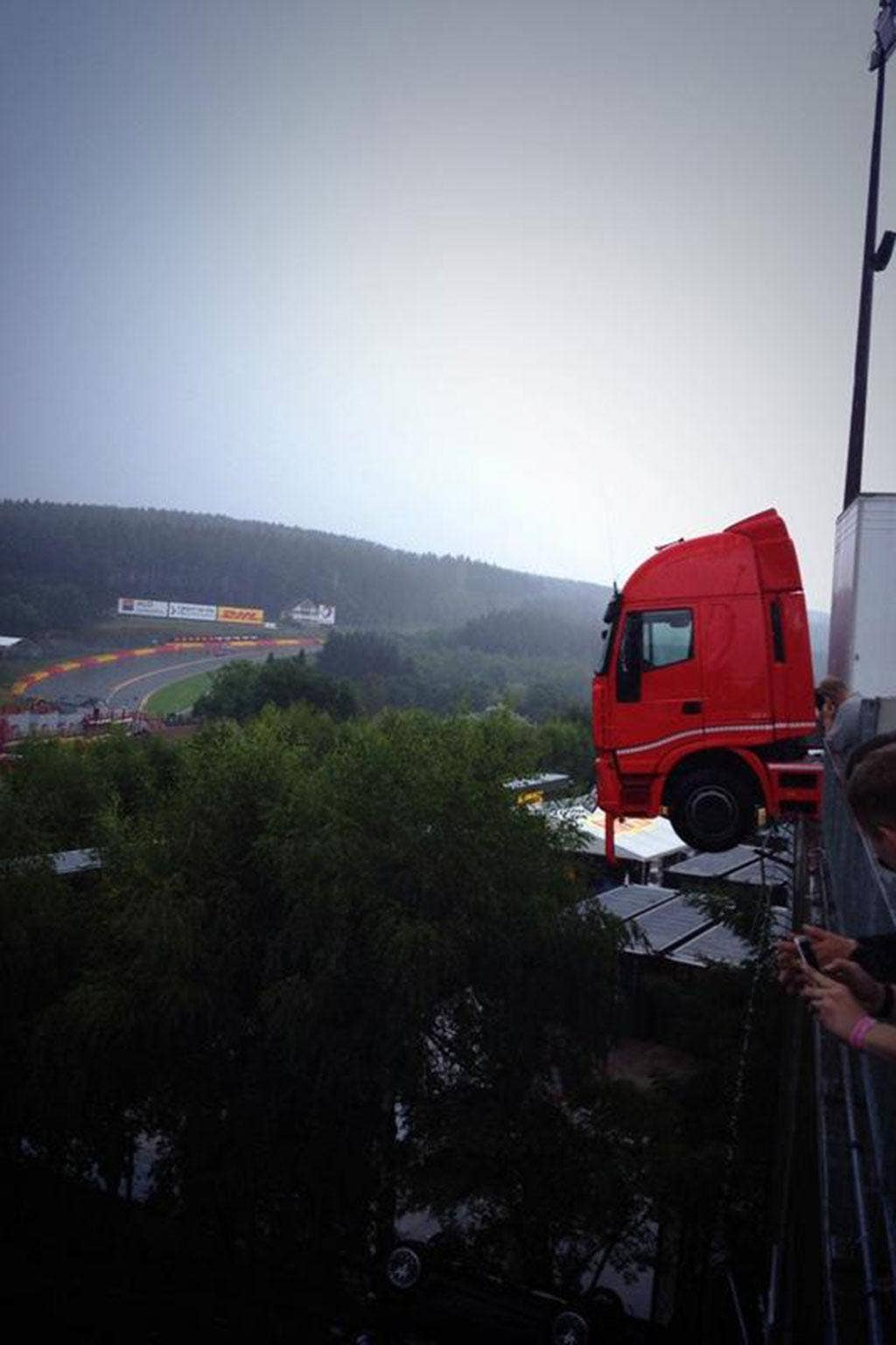 A truck hangs on the edge of a hefty drop at the Spa-Franchorchamps track