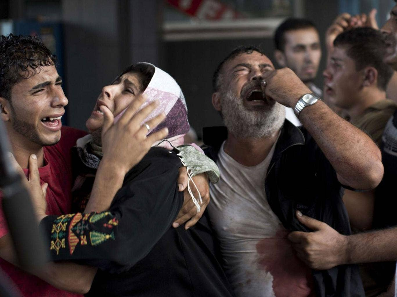Mourners at Shifa Hospital: 'Do the Israelis want to kill all our children?' one woman asked