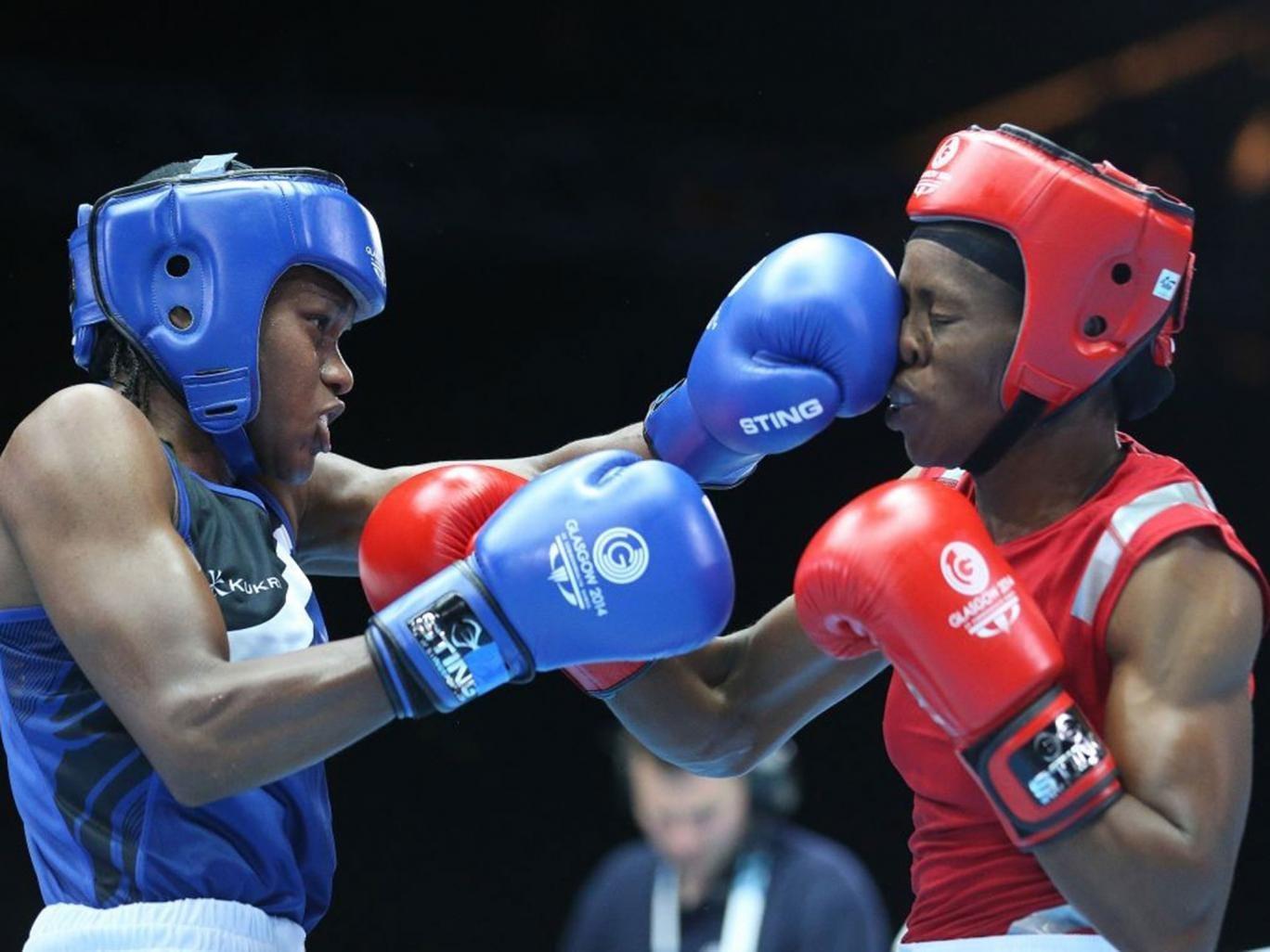 Nicola Adams lands a left jab on Nigeria's Oluwatoyin Oladeji