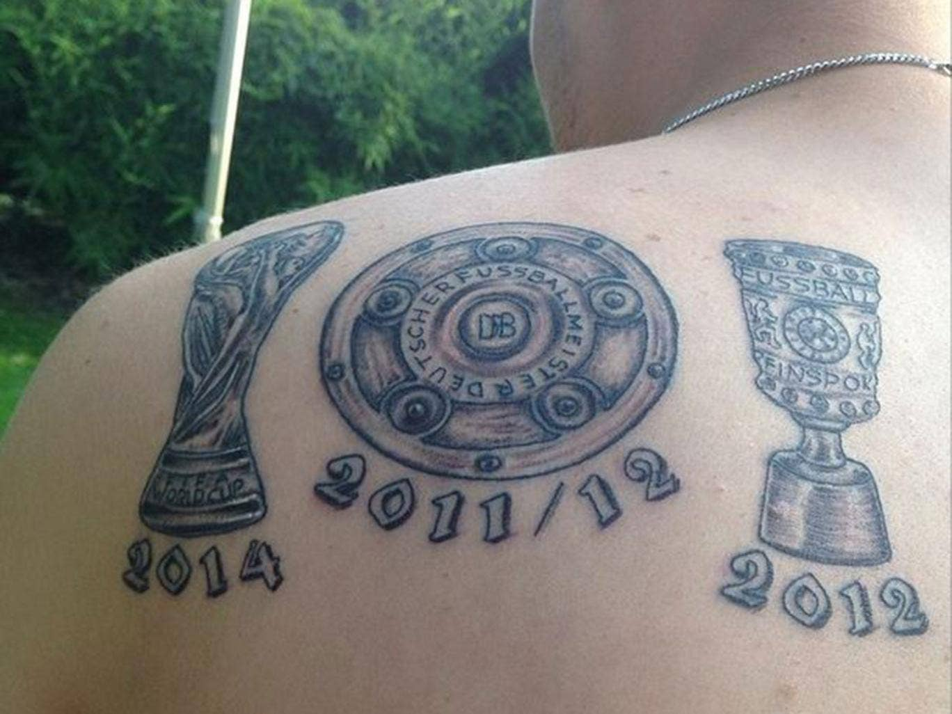Kevin Grosskreutz shows off his World Cup tattoo even though he didn't play a minute in Brazil