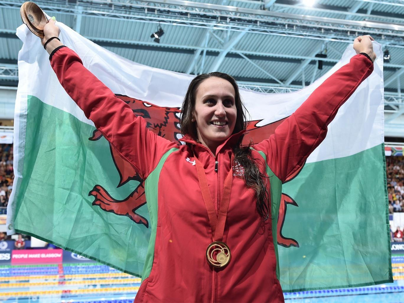 Wales' Georgia Davies wins gold in the 50m backstroke